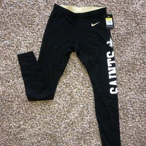 Never worn saints fan Nike leggings